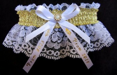 Glitzy Glitz 2015 Prom Garter Special with shiny gold metallic band & Prom 2015 imprinted ribbon tails on white lace. Prom garter tradition. garder, garders