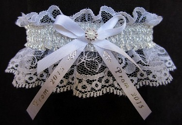 Glitzy Glitz 2015 Prom Garter Special with shiny silver metallic band & Prom 2015 imprinted ribbon tails on white lace. Prom garter tradition. garder, garders