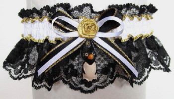 Penguin Garter in black and white. B&W Penguin Garter on black lace. garders, garder